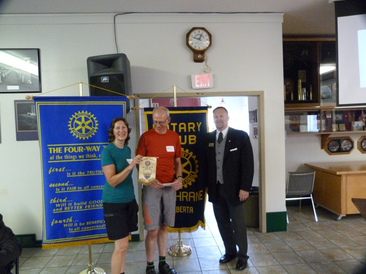 Receiving a cheque for 3,000 Canadian dollars from the Rotary Club of Cochrane. There was only the odd comment about turning up at a Rotary meeting in cycling gear!